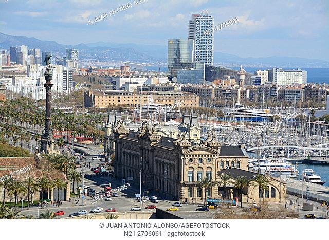 Partial view of the city of Barcelona with Christopher Columbus monument on the left, the Customs House in the centre and as part of the harbour