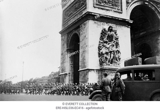 German troops marching around Arc de Triomphe, on the first day to the Nazi occupation of Paris. Four days earlier, on June 10