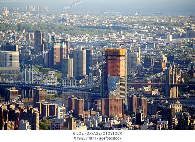 view of manhattan and brooklyn bridges with brooklyn beyond New York City USA
