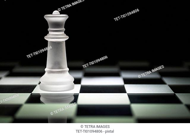 Chess queen on chess board