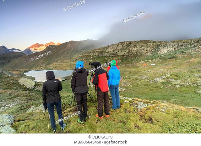 Photographers in action at dawn Minor Valley High Valtellina Livigno Lombardy Italy Europe