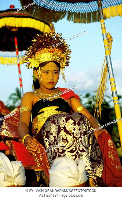 Young girl playing the incarnation of a Goddess. The Great Odalan for Singapadu Temple. Bali Island. Indonesia