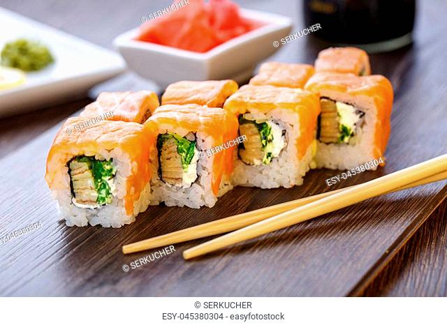Philadelphia roll sushi with salmon, prawn, avocado, cream cheese. Sushi menu. Japanese food