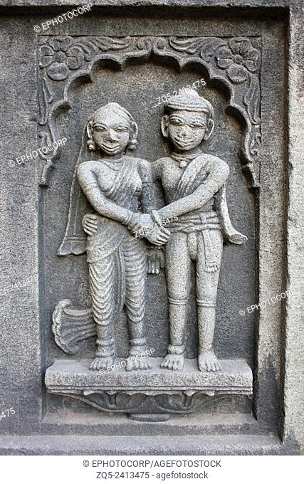Sculpture of the couple on the outer walls of Shiva temple. Ahilyabai Holkar fort, Maheswar, Khargone, Madhya Pradesh, India