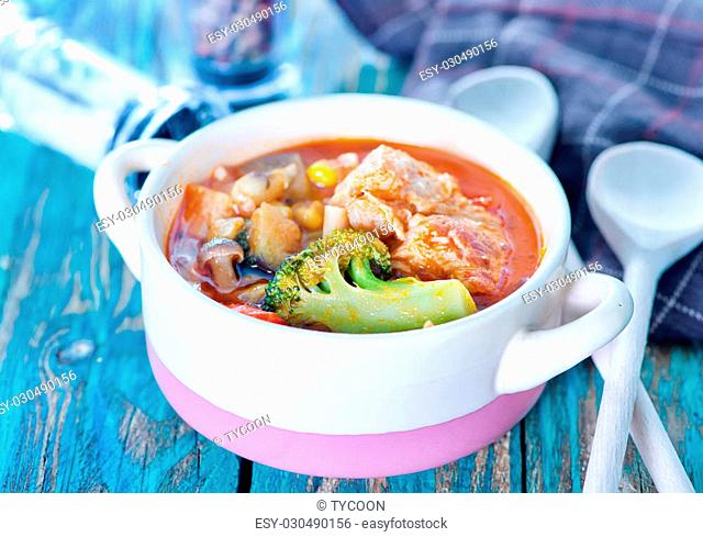 vegetables with meat and tomato sauce in the bowl