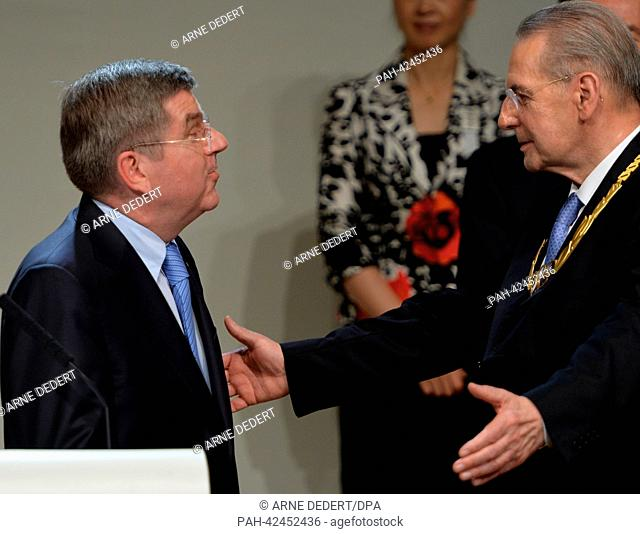 Newly elected IOC President Thomas Bach of Germany (L) is embraces by outgoing IOC President Jacques Rogge (R) at the 125th IOC Session at the Hilton hotel in...