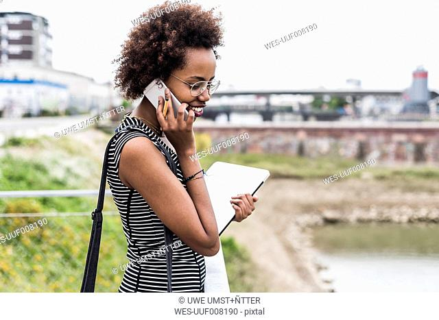 Businesswoman telephoning with cell phone
