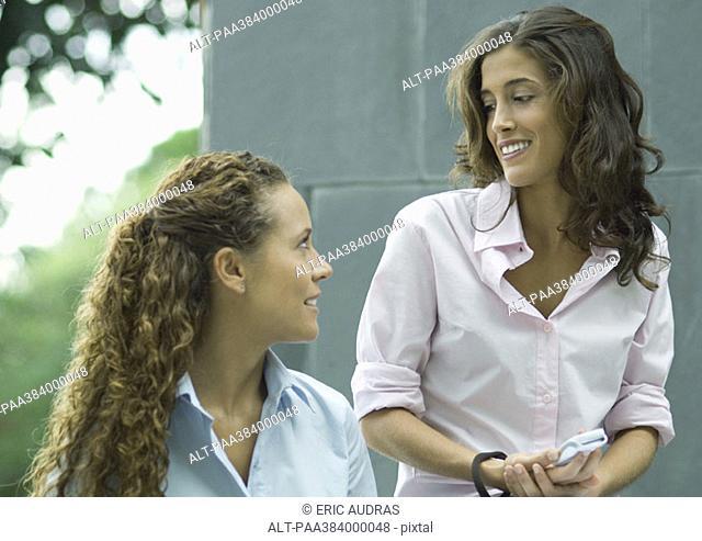 Two women, talking outdoors