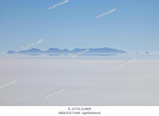 Bolivia, Salar de Uyuni, volcanoes, water mirroring
