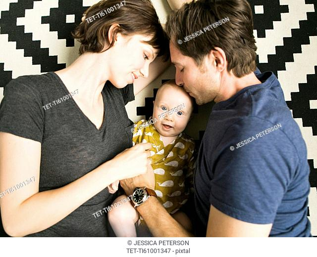Portrait of parents with baby son (2-5 months)