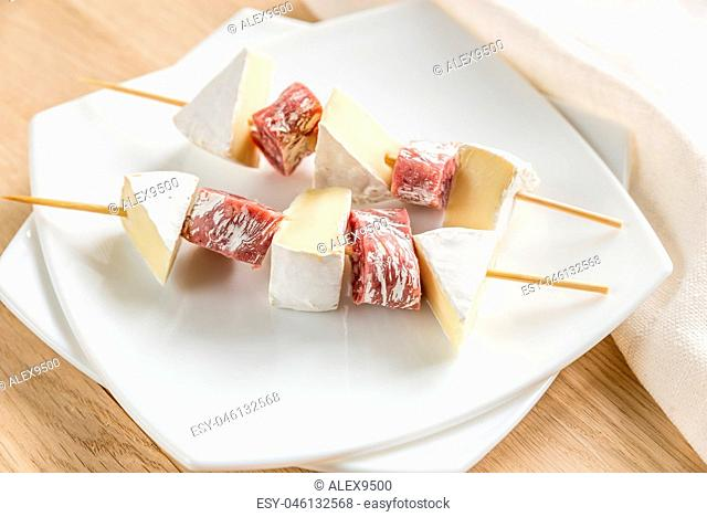 Camembert and salami skewers