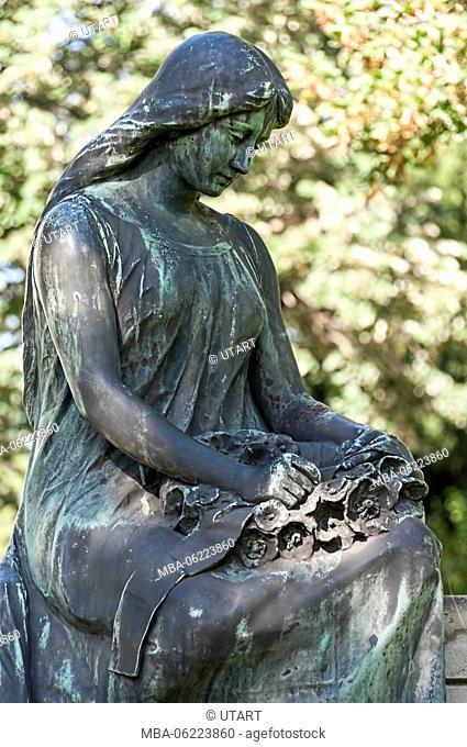 Female bronze figure in a cemetery