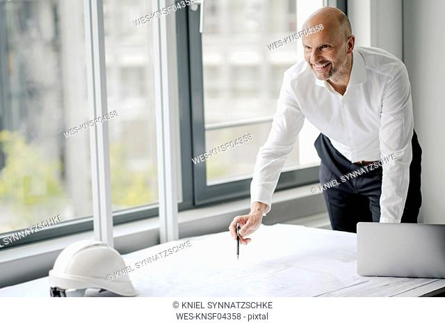 Engineer working in his office