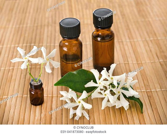 essential oils in front of white background