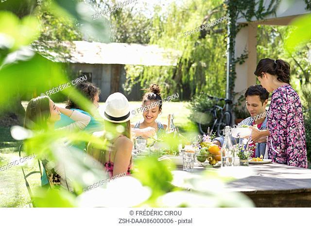 Friends enjoying meal outdoors