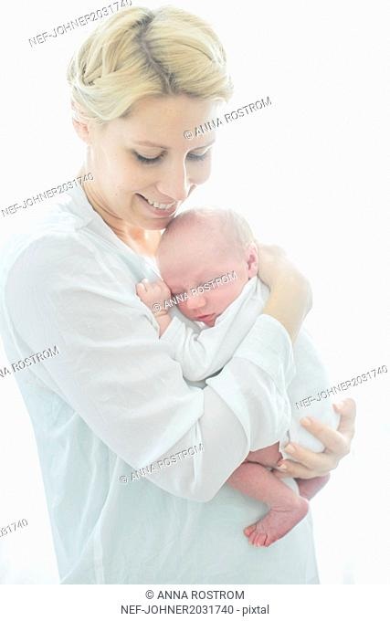 Young woman with newborn baby