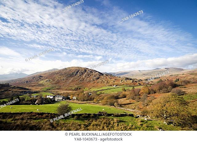 Capel Curig Conwy North Wales UK Europe  View above the village to Cefn y Capel and distant mountains in Snowdonia National Park in autumn