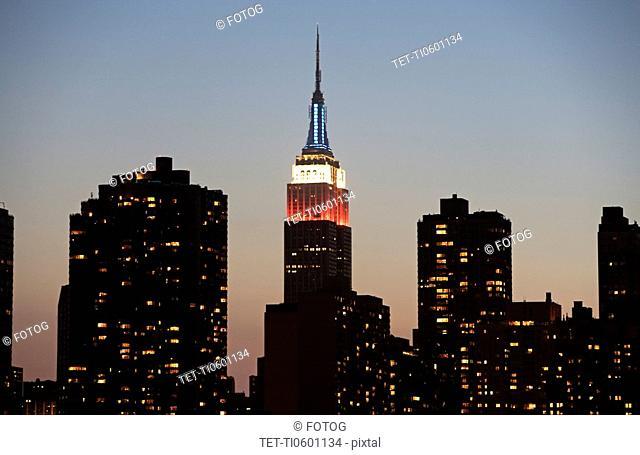 Illuminated Empire State Building at dusk