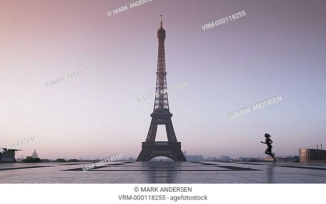 woman running in front of the Eiffel tower