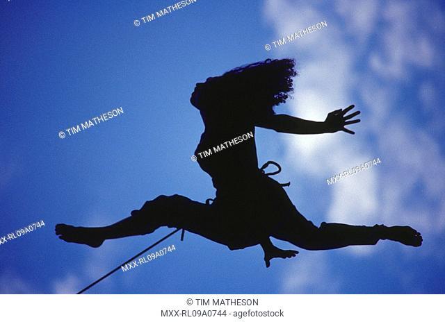 Silhouette of woman climbing