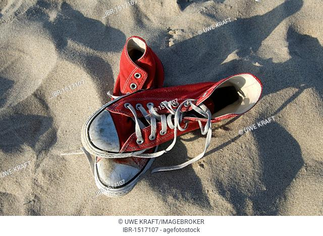Red Converse Chucks, sneakers in the sand
