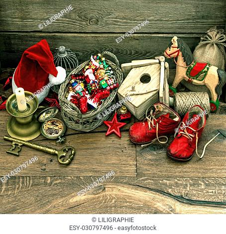 nostalgic christmas decoration with antique toys over wooden background. retro style picture