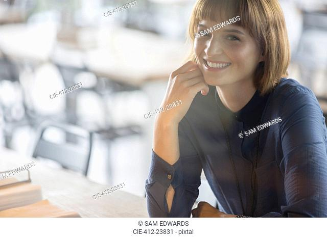 Businesswoman smiling in cafeteria