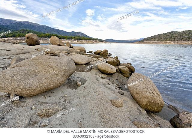 Granite at Burguillo reservoir and Sierra de Gredos on the background. Avila. Spain