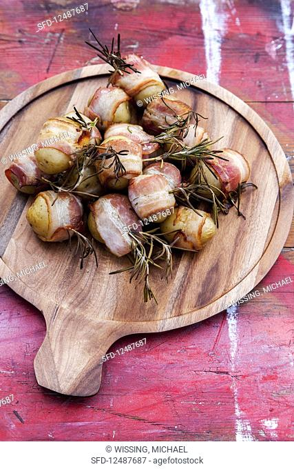 Grilled potatoes in bacon with rosemary and chilli garlic oil