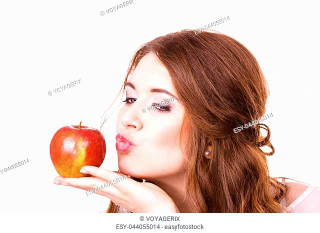 Woman holding red apple fruit in hand close to face, isolated on white. Healthy eating, high fibre diet concept