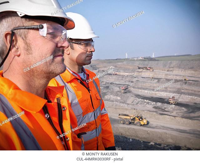 Workers overlooking coal mine