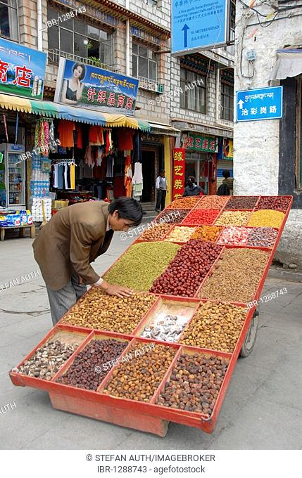 Mobile market stall, merchant selling dried fruits and nuts, historic town centre of Lhasa, Himalayas, Tibet Autonomous Region, People's Republic of China, Asia
