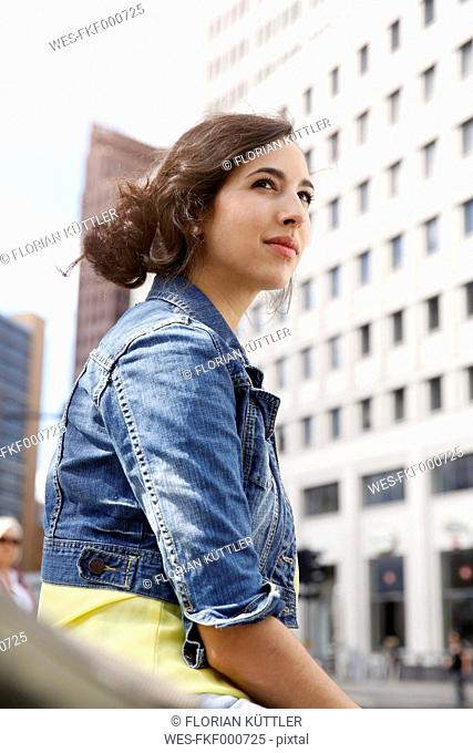 Germany, Berlin, portrait of young woman on city trip at Potsdam Square