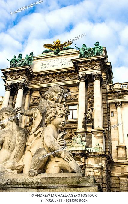 Little marble cherubs at Neue Burg building part of the Hofburg palace complex seen from Burggarten. Vienna, Austria