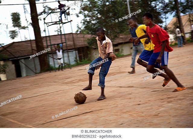 Adolescents playing soccer - football on a concrete area, Rwanda, Nyamirambo, Kigali
