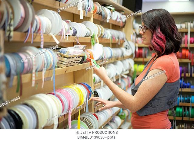 Caucasian woman shopping in fabric store