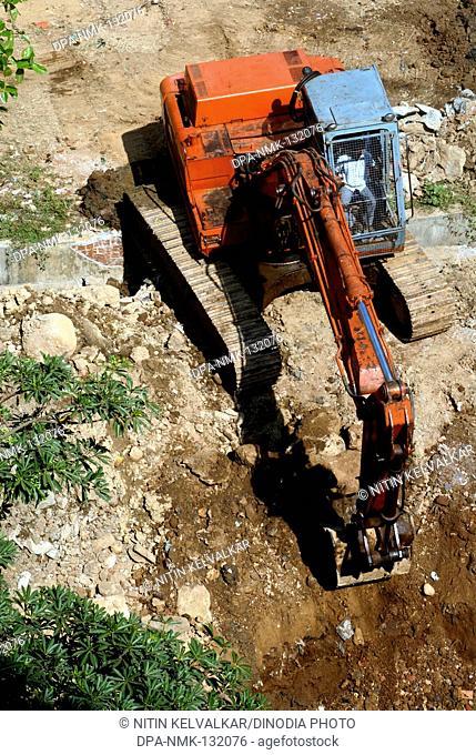 Aerial view of TATA HITACHI Excavator and Digger EX200LC at work ; Heavy Machinery at Borivali ;  Mumbai Bombay ;  Maharashtra ;  India