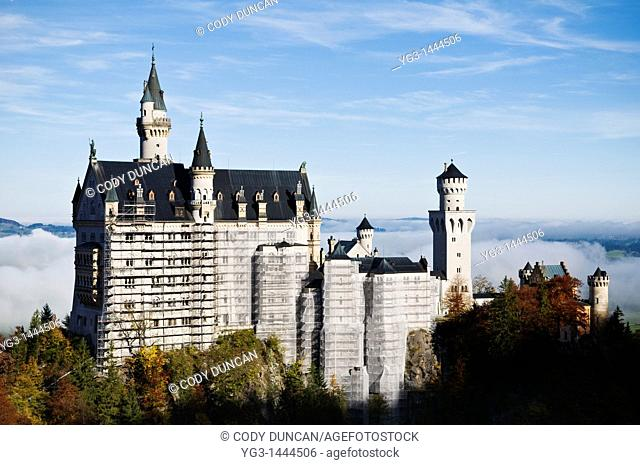 Scholss Nueschwanstein castle covered in Scaffolding for maintainence, Schwangau, Germany  October 2008