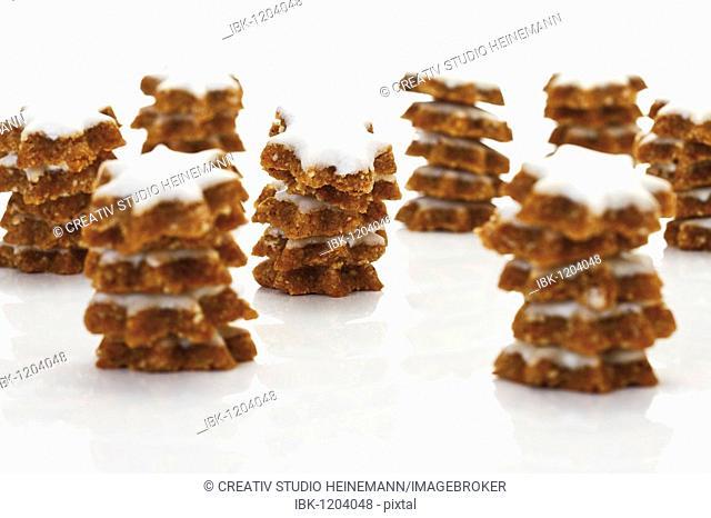 Stacks of Zimtsterne, cinnamon biscuits