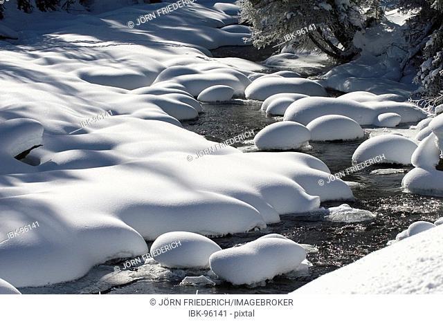 Pristine snow humps near a river