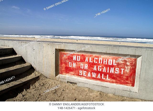 A seawall that warns against having alcohol, Pacific Beach, San Diego, California