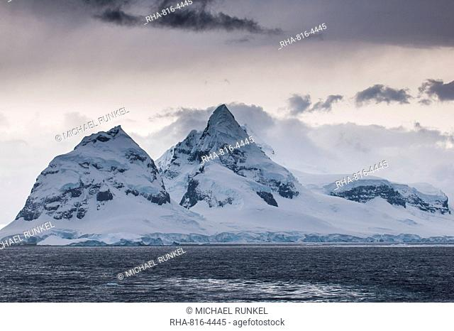 Dark clouds over the mountains and glaciers of Port Lockroy research station, Antarctica, Polar Regions