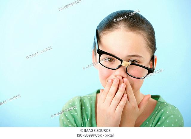 Girl wearing broken glasses