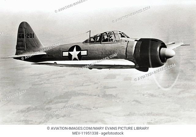 A Captured Imperial Japanese Navy Mitsubishi A6M3 Zero Wearing Us Marking Flying over Fields and Trees