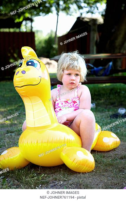 Girl sitting on a toy, Sweden