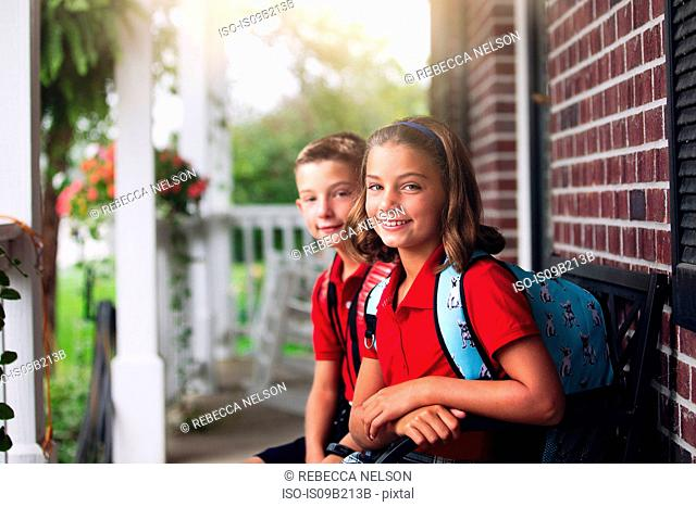 Portrait of twin brother and sister on first day of new school year