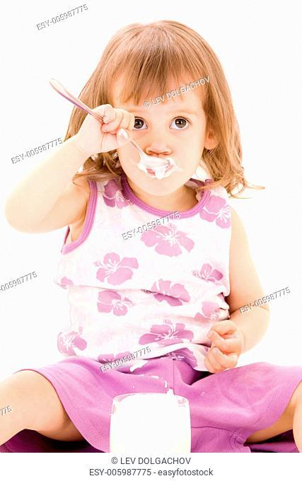 picture of little girl eating yogurt over white