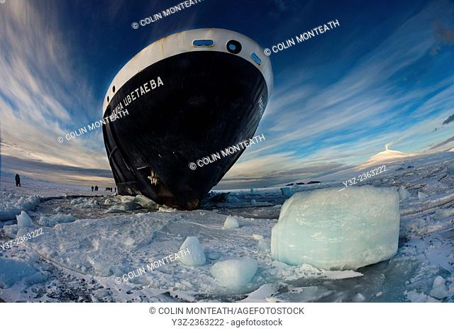 Marina Svetaeva, Ice-strengthened Russian cruise ship ( Aurora Expeditions) in McMurdo Sound - volcano Mt Erebus behind