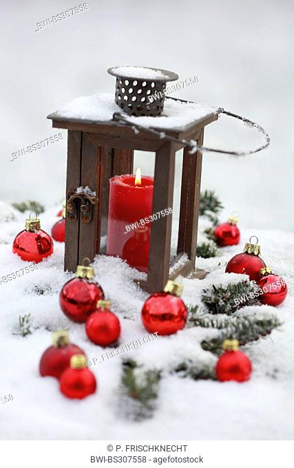 lantern and Christmas decoration in snow, Switzerland