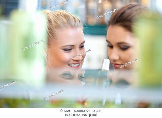Women smelling soap in store